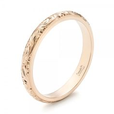 #103147 This elegant women's wedding ring features a hand-engraved scroll pattern all the way around a rounded rose gold band. It was created as part of a custom wedding set...