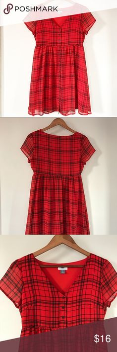 "Old Navy Red Tattersall Plaid Swing Dress Old Navy red tartan / tattersall plaid swing dress. Black button down front. Super cute winter and holiday dress for warmer areas! And would be super cute for Valentine's Day! • v Neck, short sleeve • 100% polyester  • Fully lined • Approx. measurements when laid flat: 15"" slightly stretchy waist, 33"" length, 17"" bust Old Navy Dresses Mini"