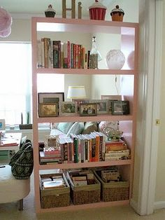 bookcase used as room divider for basement - separates play room/media room from desk area