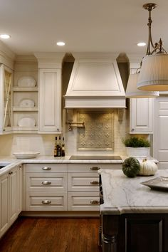 Accent back splash and creamy white cabinets.