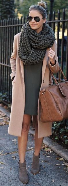 Blush coat over gray dress and cozy knit scarf.