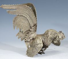 Pair of Antique Japanese Silvered Bronze Gamecock; Meiji Period | From a unique collection of antique and modern sculptures at http://www.1stdibs.com/furniture/more-furniture-collectibles/sculptures/
