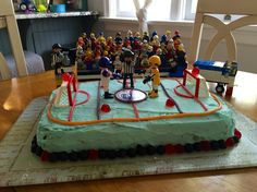 Oilers theme birthday cake! Hockey fans and all... #hockey #oilers #lego #playmobil #kidsbirthday
