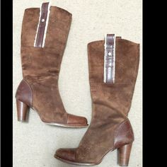 Ugg Boots Brown Ugg leather and suede Long boots in very good condition. Super comfy & stylish. Side zippers . A little distressed looking. Size 7.5 but they run like 7 UGG Shoes Winter & Rain Boots