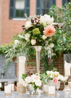 I LOVE for a high table arrangement. This is the first one I've seen that I can actually picture at my reception. Love the mix of littles underneath too