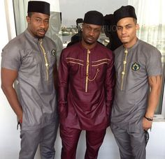 Nigerian groom (Peter Okoye) in the middle and friends at his traditional wedding celebration.