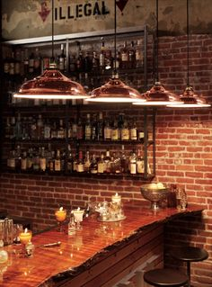 Be sure to check out the wood slab used on this bar top along with Rejuvenation's Baltimore hanging light fixture in #copper. Lots of other great design details too.