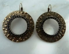 http://www.jewelrywonder.com/Jewelry-Watches-Handcrafted-Artisan-Jewelry-Earrings-Mixed-Materials/Pi-0562