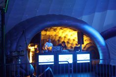#Luna inflatable, temporary structure used as DJ booth at a music event with mood lighting.  Can be used both indoors and outdoors.  #EvolutionDome #MoodLighting #LunaPod #PopUpPod #DJBooth #TemporaryStructure #InflatableStructure #TemporaryDJBooth #EventSpace #FestivalSpace #Party #PopUp #Allweather #bubbletent #Exhibition #Event