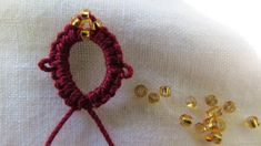 This tutorial is on how to add 4 beads to your needle tatting work