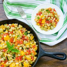 Succotash - A Southern mixed vegetable dish made with corn, lima beans, zucchini, tomatoes, and onion.