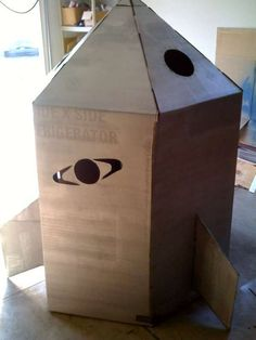 cardboard box rocket ship for space themed responsibility pack meeting