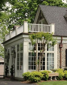 Sunroom w balcony and french doors...want it!