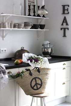 "I like that the word ""eat"" is on the wall. I love decorations like that, but our kitchen would have something a little more clever."
