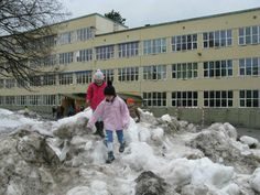 Schoolyard in springtime. Snow becoming black from sand and gravel. Oslo.