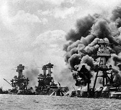 ... the damaged USS Tennessee, and the sunken USS Arizona in Pearl Harbor