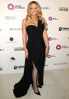 MARIAH CAREY wears a figure-flattering one-shoulder black Brandon Maxwell gown with sheer hose, black heels and (what else, dahling?) tons of diamonds, including that epic ring at the Elton John AIDS Foundation Oscars viewing party. Mariah Carey Whitney Houston, Mariah Carey 90s, Elton John Aids Foundation, Viva Glam, Strapless Dress Formal, Formal Dresses, Oscar Dresses, Red Carpet Event, Party Dress