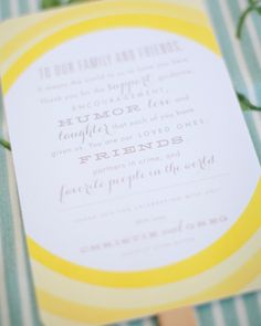 Ceremony proceedings at this real wedding were outlined on cheery yellow fans, with a thank-you note to guests written on the backs.