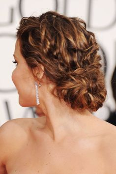 "With its tousled and organic framework that flows into a more carefully crafted low chignon, Jennifer Lawrence's updo provides the best of both worlds. ""It is still formal, but fun and romantic,"" said Jen Atkin, who counts Lawrence as a client. ""This look would be great for a fall wedding or for a modern bride who isn't afraid of playing with texture in her hair."" To get such great texture and movement, Atkin said it's crucial to start with a nourished scalp. She recommended Clear Scalp ..."
