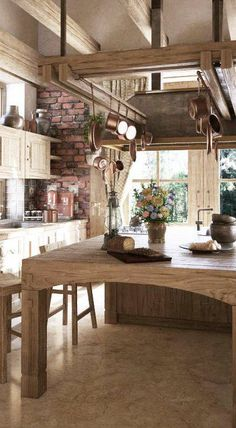 Island would look nice in our cabin. I like the hanging pots and pans too.