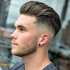 Long Brushed Back Hair with High Bald Fade and Stubble