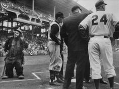 Emmet Kelly at Dodgers Game  as Pirates Player Dick Groat  and Dodger Manager Walter Alston confer http://clownpictures.info/emmett-kelly-photo-gallery/  http://famousclowns.org/famous-clowns/emmett-kelly-sr-biography-world-famous-tramp-clown/