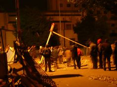 Anti-government protesters test a makeshift catapult at the Kasr al-Nil bridge entrance into the square. An al-Jazeera reporter witnessed two such catapults being used in the square. Guys will be guys...