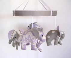 Lavender Grey Baby MobileCrib MobileElephant Nursery by MemeFleury, $98.50  She used fabrics and patterns from our nursery to create this item! Amazing to work with her.    http://www.etsy.com/listing/156176006/lavender-grey-baby-mobile-crib-mobile?ref=af_shop_favitem