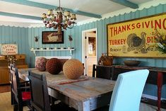 I love everything about this. . .the colors, chunky vintage distressed furniture, cozy corner fireplace. . .aaahhhh!