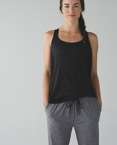 We made this tank with a draping, open back so we can keep cool in class—and show off the strappy bra underneath. Sweat-wicking with low armholes that give us room to move, it lets us focus on our practice in Hatha, Hot and Vinyasa Flow.