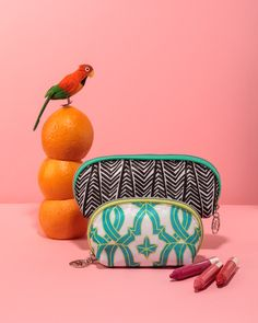 Sonia Kashuk Tribal Print Pencil Case, $7.62, available at Target; Sonia Kashuk Tile Print Cosmetic Bag, $5.99, available at Target; Clinique Chubby Stick Moisturizing Lip Colour Balm in Pudgy Peony, Oversized Orange, and Two Ton Tomato; $16 each; available at Clinique.