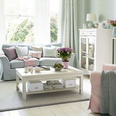 White furniture with pastel blues and pinks