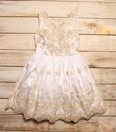Gorgeous fit and flare dress with gold embroidery.