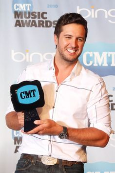 Luke Bryan with His Shirt Off | Luke Bryan shows off his award for USA Weekend Breakthrough Video of ...