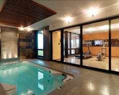 Home Workout Room Design, Pictures, Remodel, Decor and Ideas -  pretty cool workout room with an indoor pool.  Looks like it also has a skylight..if not, I would add one!