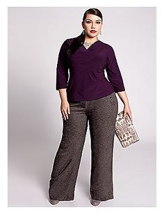 Pair wide leg pants with a solid colored blouse to create a timeless office look