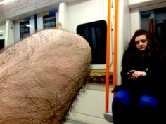 someones knee, a girl and me. (southbound overground. 11.05 pm)