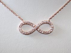 NEW - Infinity Necklace, Rose Gold Filled CZ Eternity Necklace As seen on Reese Witherspoon - Celebrity Inspired. $35.00, via Etsy.