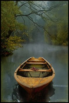 The Old Lake by Carlos Casamayor ~   The Old Lake (long life)This is not a real photograph. It is a realistic painting created intentionally.It is really a tribute to the memory of my parents who are both in the other life.  The boat is a symbol of people's lives. The boat in the foreground with the lake behind wants to express the journey of life from birth until the end. In this case, the end of life.