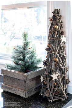 Christmas junk home tour 2017 Tall twig with copper ornaments Christmas tree from Urban Barn, with mini Christmas tree in a crate from Lowes, part of Funky Junk Interiors' Christmas home tour. See it all at funkyjunkinterior… Miniature Christmas Trees, Mini Christmas Tree, Country Christmas, Xmas Tree, Christmas Home, Christmas Tree Ornaments, Christmas Holidays, Christmas Branches, Driftwood Christmas Tree