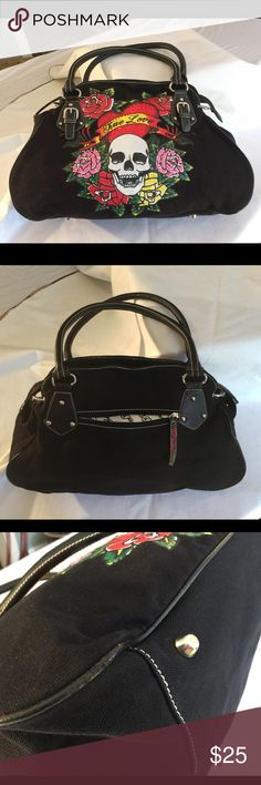 """Ed Hardy Black Satchel In good condition, this canvas bag has a little schmutz on the top of the interior, shown in photo and a tiny bit of wear on the piping on one corner, shown in other picture. Otherwise fabulous with leather handles and silver buckles. Measures 18"""" across the bottom, 12"""" high, 6"""" deep. Drop from shoulder about 10"""" Ed Hardy Bags Satchels"""