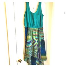Teal high low dress Lovely flowing high-low dress. Comes with brown braided belt that goes on the waist  loops. Small Charlotte Russe Dresses High Low