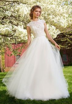 Ivory Tulle ball gown with beaded illusion neckline and capped sleeves, lace sweetheart underlay, sheer back with encrusted belt at natural waist and chapel train.