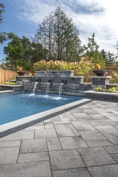 Modern unilock pool deck installed with umbriano paver with u-cara water feature - Photos