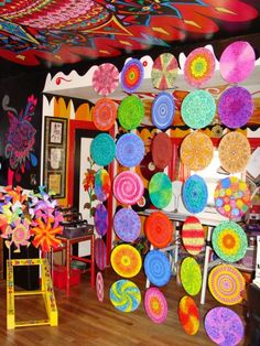 Use vinyl records as design elements, painted and decorated as needed - Recycled Vinyl Record Mandala Room Divider