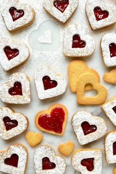 Valentine's Day Linzer biscuits (cookies) - delicious heart shaped almond biscuits filled with raspberry jam, perfect for any time of year! Jelly Cookies, Biscuit Cookies, Biscuit Recipe, Sugar Cookies, Linzer Cookies, Heart Cookies, Baby Cookies, Easter Cookies, Christmas Cookies