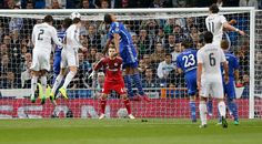 Cristiano Ronaldo of Real Madrid CF scores his team's first goal during the UEFA Champions League round of 16 second leg match between Real Madrid CF and FC Schalke 04 at Estadio Santiago Bernabeu on March 10, 2015 in Madrid, Spain.