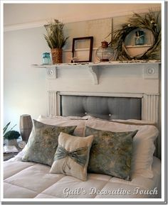 Love this old fireplace mantel with the upholstered piece on the inside!  I need this!