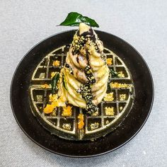 Black & Gold ice cream on charcoal waffles with salted egg yolk and curry leaves at STRAY #sgeats #sgfood #sgrestaurant #newopeningsg #straybyfatcat #ordinarypatrons