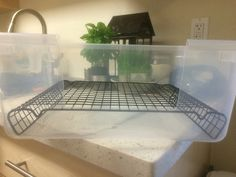 Put them together and you got a nice wall high litter box.  Bending the cooling sheet to size u need and cutting the box carefully to make sure you don't crack it. You can use pine or cat litter sense the bunny won't be touching it because of the cooling sheet. You can make it out of any container you choose.